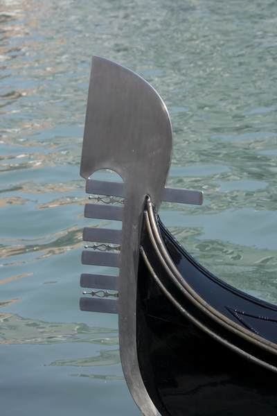 A metal ferro on the prow of a gondola on the Grand Canal in Venice, Italy, Europe
