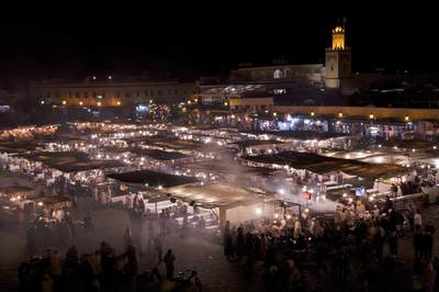 The busy night food market in the square of Jmaa El Fna in Marrakesh Marrakech in Morocco in Africa