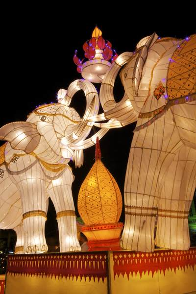 Display of colourful 'Lanna'  elephant lanterns displayed during the November festival of Loy (Loi) Krathon (known locally as Yi Peng) located near the 3-Kings monument in the Old City in Chiang Mai in Thailand