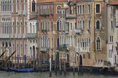 17th century Venetian Palazzos on the Grand Canal in Venice with Traghetto mooring and moored gondolas, Italy, Europe