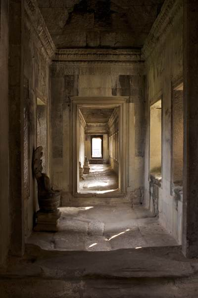 Shaded interior of an inner concentric gallery showing doorways leading to further 'rooms' in the centre of Angkor Wat near Siem Reap in Cambodia