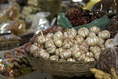 Basket of fresh garlic and bags of chillies in the Phsar Chas (Old Market) in Siem Reap in Cambodia