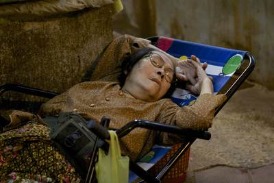 A stall holder takes a break from work to sleep at the Phsar Chas (Old Market) in Siem Reap in Cambodia