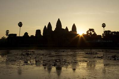 Sunrise at Angkor Wat viewed from inside the outer walls, eastwards over the central temple complex, a temple complex built for king Suryavarman II in the early 12th century as his state temple and Khmer capital city near Siem Reap in Cambodia