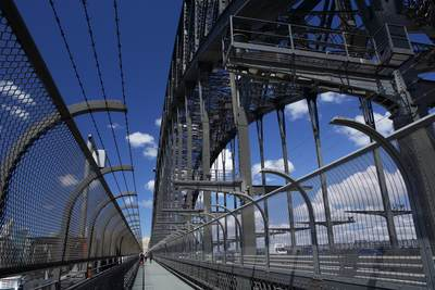 Metal walkway across the Sydney Harbour bridge in Sydney on a sunny morning, in New South Wales in Australia