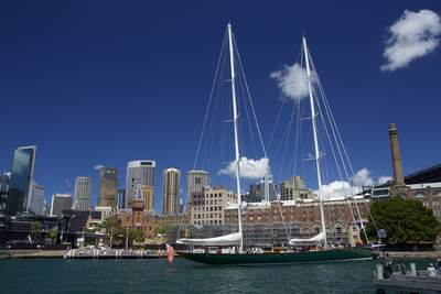 View across Circular Quay with a super yacht in the foreground in Sydney on a sunny morning, New South Wales in Australia