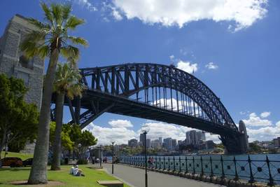 View of the side of the metal Sydney Harbour bridge seen from the Hickson Road Reserve in Sydney on a sunny morning, in New South Wales in Australia