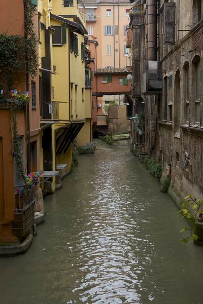 Hidden canal in between buildings in Bologna in the Emilia-Romagna district of Northern Italy