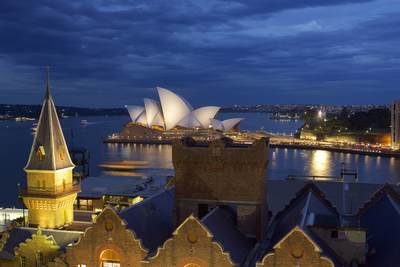 View across rooftops of the Sydney Opera House and Circular Quay at dusk in Sydney, New South Wales in Australia
