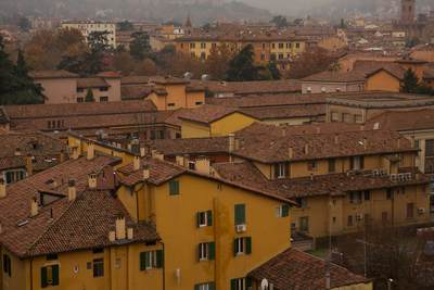View across the red tiled roofs of buildings in Bologna in the Emilia-Romagna district of Northern Italy