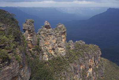 The Three Sisters - a rock formation in the Blue Mountains of New South Wales, Australia, on the north escarpment of the Jamison Valley, close to the town of Katoomba and one of the Blue Mountains' best known sites - their names are Meehni, Wimlah, and Gunnedoo