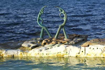 A public art sculpture made from stone and ceramics called 'The Oceanides' by Sculptor Helen Leete at Fairy Bower pool near Manly, near Sydney, New South Wales, Australia