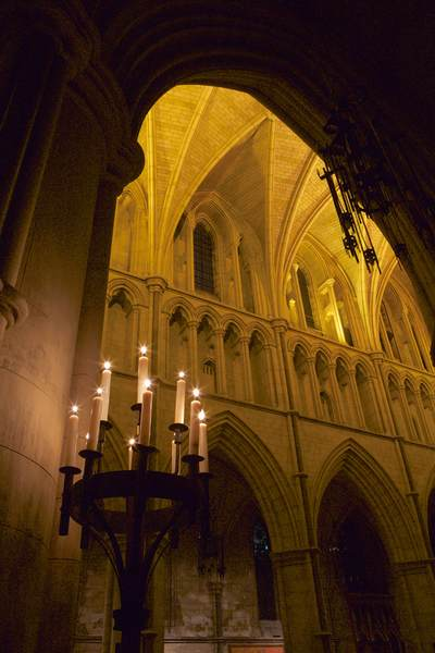 View of candles and architecture from the 13th century during a candle light evening at Southwark Cathedral in London United Kingdom