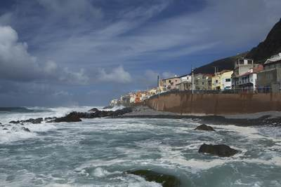 Winter waves crash on the beach of Paul do Mar, a small fishing village in South West Madeira, a Portuguese Portugal Island in the Atlantic