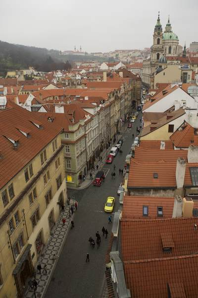 Aerial view towards Prague Castle with red tiled roofs of houses on a winters day in the Czech Republic