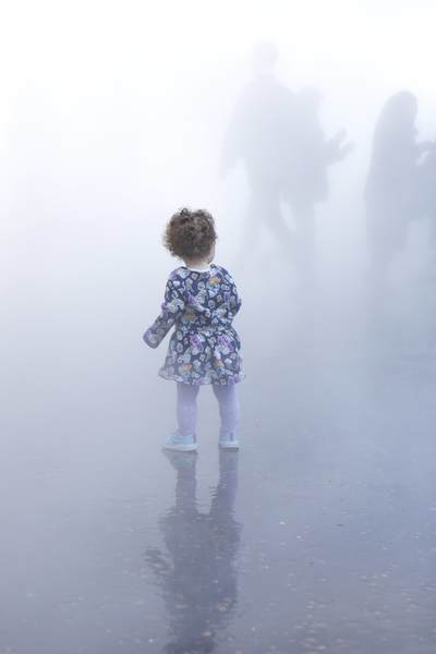 A young child walks through the 'London Fog' art installation by Japanese artist Fujiko Nakaya at the Tate Modern art gallery in London United Kingdom