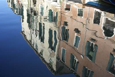 Reflections of buildings in a canal in Venice in the Dorsoduro district, Italy Europe