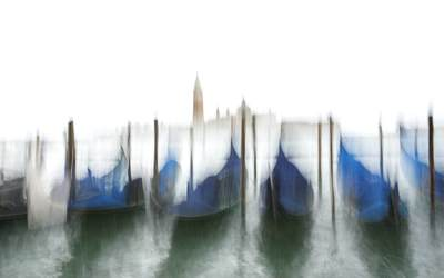 View of gondolas and Venice in the rain looking towards the Guidecca district of the city using intentional camera movement ICM in Italy Europe