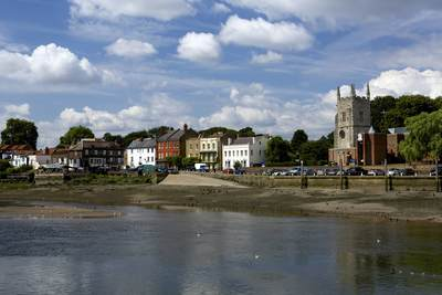 The town of Isleworth on the banks of the river Thames at low tide on a sunny summer day in London United Kingdom