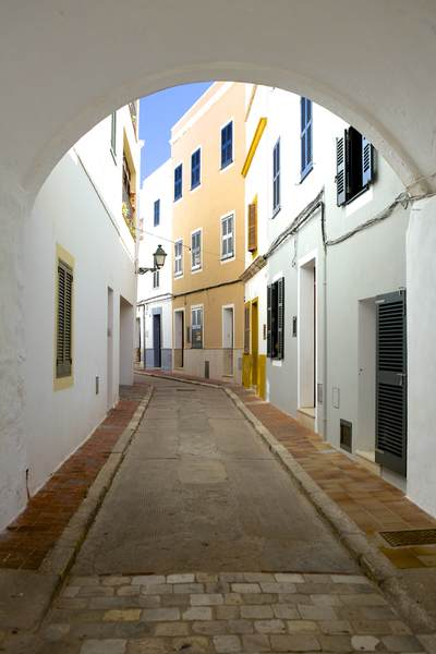 Colourful houses in the back streets of the old part of Ciutadella in Menorca, part of the Balearics in Spain Europe