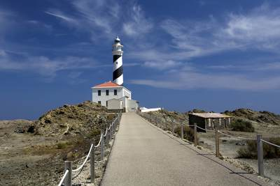 The Cap de Favaritx lighthouse in the Parc Natural de S'Albufera on Menorca, part of the Balearics in Spain Europe