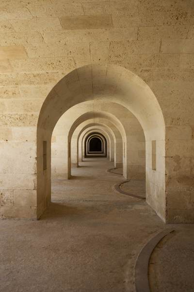 A perfect line of arches - architecture of the fort - La Mola, built in the 1830's and now a monument to visit on Menorca, part of the Balearics in Spain Europe