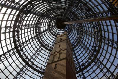 The architecture and wrought ironwork of Coop's Shot Tower built in 1888 in the Melbourne Central shopping centre, in Melbourne, Victoria, Australia