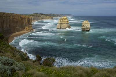 The Twelve Apostles with surf, a collection of limestone stacks off the shore of the Port Campbell National Park, by the Great Ocean Road in Victoria, Australia