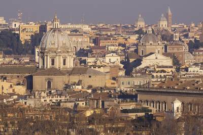 View of the city of Rome in late afternoon light with the dome of Sant'Andrea della Valle in the foreground in Rome, Lazio in Italy Europe