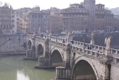 View across the pedestrianised Ponte Sant'Angelo (Aelian Bridge or Pons Aelius) faced with travertine marble and spanning the Tiber (Tevere) with 3 arches, in early morning haze in Rome, Lazio, Italy Europe