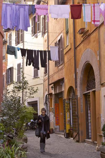 Lines of laundry hangs above a narrow cobbled street in the Trastavere district of Rome, Lazio, Italy, Europe