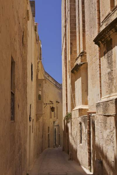 A narrow street with wrought iron lamps and a traditional balcony in Mdina (Citta Vecchia - Old City), Malta, Europe
