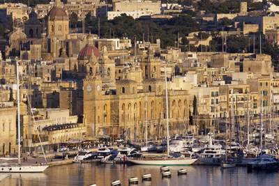 District of Birgu (Vittoriosa) with the cupolas of the church of San Lawrenz, at sunset in Valletta in Malta in Europe