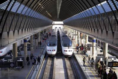 A view down on to platforms 3 and 4 of Santa Justa railway station with 2 AVE - Alta Velocidad Española - high-speed trains in Seville, Spain in Europe