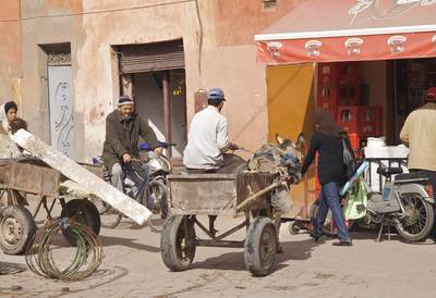 Pedestrian, animal and bike traffic all meet in the Medina near the tanneries in Marrakech Marrakesh in Morocco in Africa