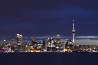 Skyline of the city of Auckland (City of Sails), with the Sky Tower (tallest free-standing structure in the Southern Hemisphere), viewed across Waitemata Harbour, commonly referred to as Auckland Harbour at dusk in North Island New Zealand