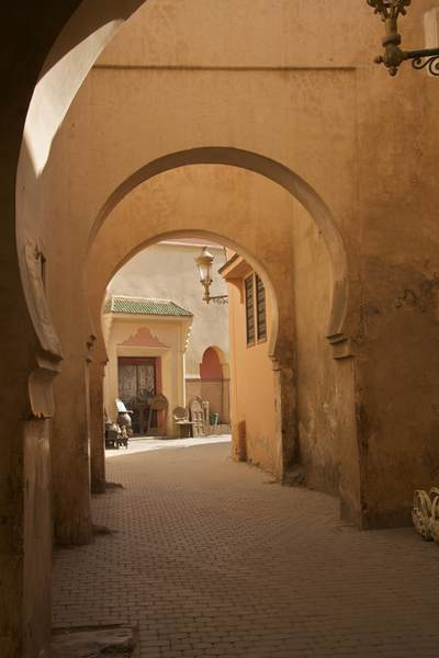 Arched cobbled street in the shade in the Northern Medina in Marrakech Marrakesh in Morocco in Africa