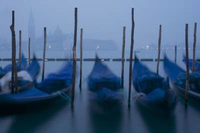 View of gondolas and Venice at dawn looking towards the Guidecca district of the city in Italy Europe