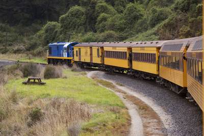 A DJ class locomotive (DJ1209) a diesel-electric locomotive pulling carriages travels along the privately owned Taieri Gorge railway near Dunedin on South Island in New Zealand