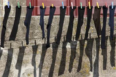 Socks drying on a washing line outside of a building in the Ribeira district on Porto on a sunny day in Northern Portugal, Europe