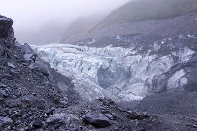 The glacier 'terminal' of Fox Glacier (Te Moeka o Tuawe) - 13-kilometre (8.1 mi) long, located in Westland Tai Poutini National Park in South Island in New Zealand