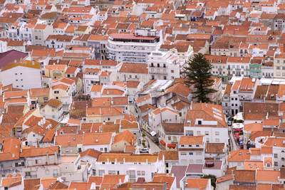 View down onto the main town of Nazaré, viewed from Sítio (old Nazaré) in Obidos, Portugal, Europe