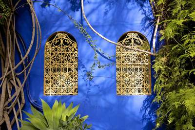 Ochre wrought-ironwork in the cobalt blue wall of the pavilion in the Majorelle gardens, bequeathed to the people of Marrakech by Yves Saint Laurent in Morocco