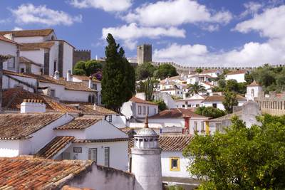 View across the rooftops of the walled town of Óbidos (The 'Wedding City'), Portugal Europe