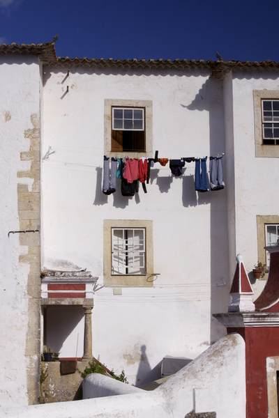 A line of washing hanging outside of a house in the town of Óbidos (a.k.a. The 'Wedding City'), Portugal Europe