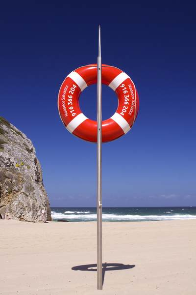 Lifeguard ring buoy for beach rescues on Adraga beach in Portugal, Europe