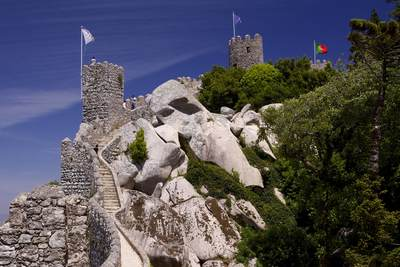View along the ramparts of the Castel Mouros (Moorish Castle) built in the ninth century, towards the watch towers, on the ridge of the Sierra de Sintra in Portugal in Europe