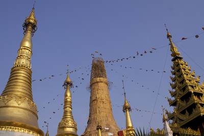 A collection of zedis (stupas) covered in gold leaf and other zedis linked with strings of prayer flags in the Shwedagon Pagoda (Shwedagon Zedi Daw) - this current form dates from 1769 in Yangon (Rangoon) in Myanmar (Burma)