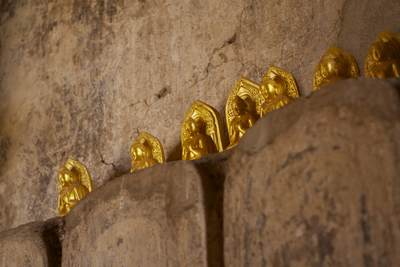 Miniature gold coloured Buddhas left as offerings to Buddha at the Shwegugyi Temple meaning 'the Golden Cave' (a.k.a. Nandaw Oo Paya) in Bagan in Myanmar (Burma)