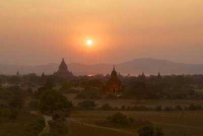Sunset over the plain of temples in Bagan viewed from the terraces of the Shwesandaw Paya temple in Bagan in Myanmar (Burma)